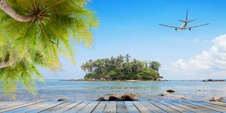 Wood floor with coconut palm trees on tropical island and airpla. Ne,concept summer and travel background Royalty Free Stock Photo