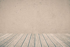 Wood floor and concrete wall royalty free stock photo