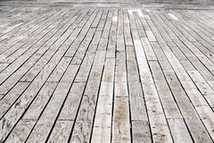 Rusty nails and raised wood decking panels stock images