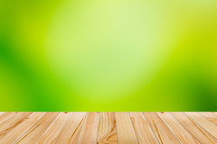 Wood floor with green abstract blurred background. Wood floor and green background Royalty Free Stock Photo