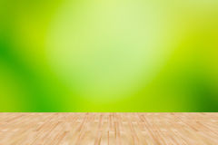 Wood floor with green abstract blurred background. Wood floor and green background Stock Image