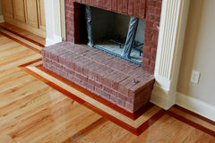 Wood Floor Inlay. Three row wood floor border around brick fireplace Stock Photography
