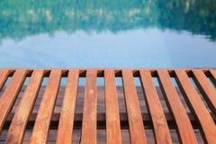 Wood floor near swimming pool Royalty Free Stock Image