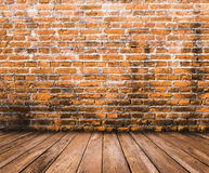 Wood floor with old brick wall background. Wood floor with old red brick wall background Royalty Free Stock Images