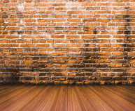 Wood floor with old brick wall background. Wood floor with old red brick wall background Stock Image