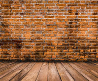 Wood floor with old brick wall background. Wood floor with old red brick wall background Royalty Free Stock Photos
