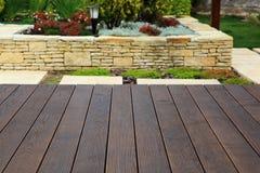 Wood floor over background beautiful modern decorative garden de Royalty Free Stock Images
