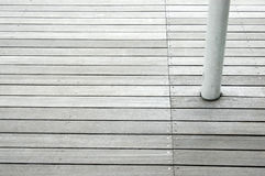 Wood floor panels with white column. Wood patio floor with a white column Royalty Free Stock Images