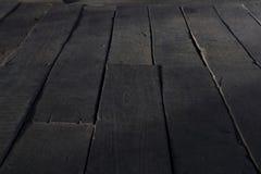Wood floor in perspective. Dark wood floor in perspective view can be use to floor background or wallpaper Stock Photo