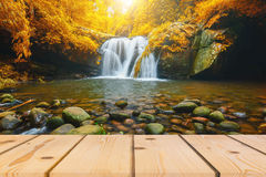 Wood floor perspective and natural mountain waterfall Royalty Free Stock Image
