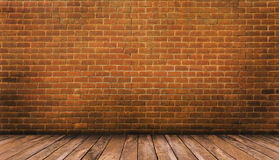 Wood floor and red brick wall Royalty Free Stock Images