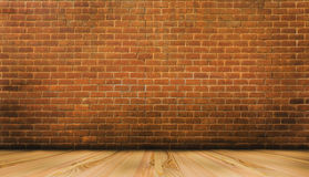 Wood floor and red brick wall. Background Stock Images