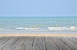 wood floor on sand beach with sea and blue sky beautiful natural tropical sea stock photography