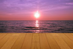 Wood floor on sea with purple sunset Burning Skie beautiful natural tropical sea Stock Image