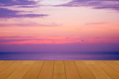 Wood floor on sea with purple sunset Burning Skie beautiful natural tropical sea Stock Images