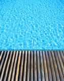 Wood floor beside the swimming pool Royalty Free Stock Photo