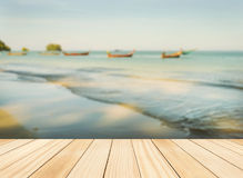 Wood floor top on blue sea in morning light Royalty Free Stock Image