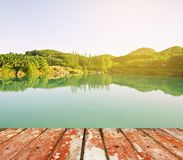 Wood floor top on river in nature Royalty Free Stock Photos