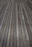 Wood Flooring Outdoor Deck. Wood Flooring deck with gray wood slats going vertical up the picture frame. Texture and good skilled workmanship in the construction stock images