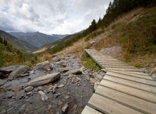 Wood flooring over a mountain river. Mountain, forest, clouds, d Stock Photography