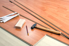 Wood flooring and tools. The wood flooring and tools Royalty Free Stock Image