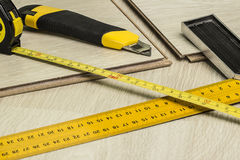 Wood flooring and tools Royalty Free Stock Image