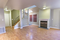 Wood floors, fireplace and colorful walls in spacious empty townhouse. Living room in model home in southern California ready for a real estate shoot Stock Photography