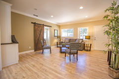 Wood floors in open living room with bamboo tree Stock Images