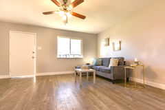 Wood floors and small couch in living room Royalty Free Stock Photography