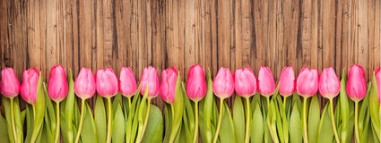 Wood flower. Flower tulips background on wooden table Royalty Free Stock Image