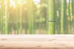 Wood foreground with blur bamboo wood forest background. Design for display nature products Stock Photo