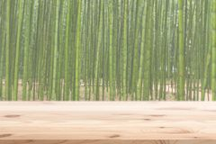Wood foreground with blur bamboo wood forest background. Design for display nature products Royalty Free Stock Images