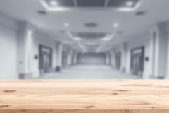 Wood foreground with blur interior modern building Stock Images
