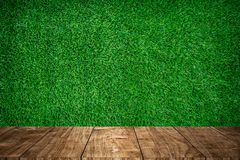 Wood foreground with green grass sport field. Background design for display nature products Stock Photography