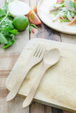 Wood fork and spoon on chopping block and ingredient of thai spi Royalty Free Stock Photos