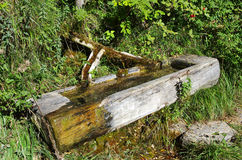 Wood fountain on the dolomites Stock Photography