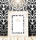 Wood frame in a black and white patterned Wallpaper. Wall of the room wallpapered with beautiful black and white picture, light wooden bottom surface, in the Stock Photos