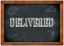 Wood frame blackboard with DELIVERED text written with chalk. Illustration Royalty Free Stock Image