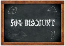 Wood frame blackboard with 50 PERCENT DISCOUNT text written with chalk. Illustration Stock Photos