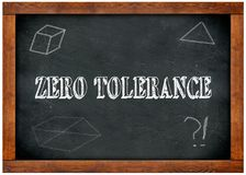 Wood frame blackboard with ZERO TOLERANCE text written with chalk. Royalty Free Stock Images