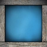 Wood frame with blue paper Royalty Free Stock Photos