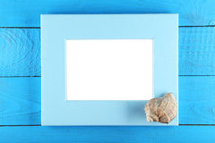 Wood frame on blue wooden background. Stock Photography