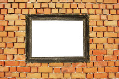 Wood frame on brick wall. Wood frame on a brick wall and white center Royalty Free Stock Photography