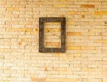 Wood frame on brick wall Stock Photos