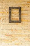 Wood frame on brick wall Stock Images