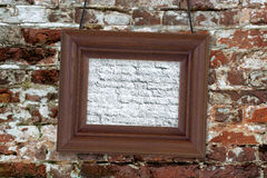 Wood frame on brick wall Stock Image