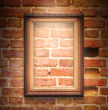 The wood frame on brown brick wall Stock Photography