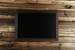 Wood frame on brown wooden background. royalty free stock image