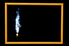 Wood frame candle on the black background royalty free stock photo