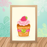 Wood frame on the desk with doodles and cupcake Royalty Free Stock Photo